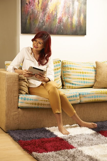 image victoria-with-ipad-on-couch-sitting-1-jpg